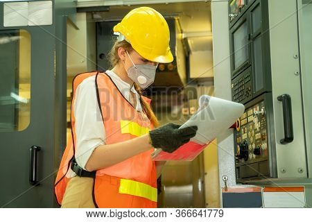 Factory Woman Wearing Hygienic Mask To Protect Against Covid-19 Working And Checking Machine In Fact