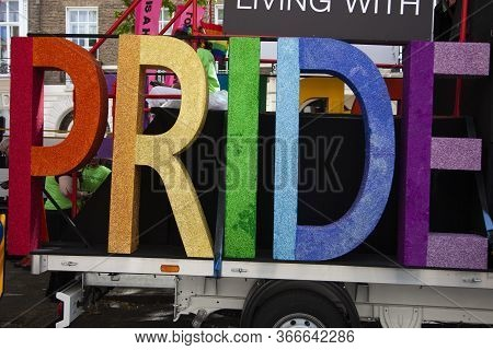 London, Uk - July 6th 2019: Pride Word In Gay Pride Rainbow Colours On The Side Of A Pride Festival