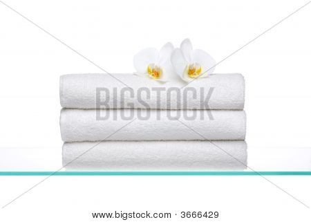 Fresh  Towels On Glass With Orchids