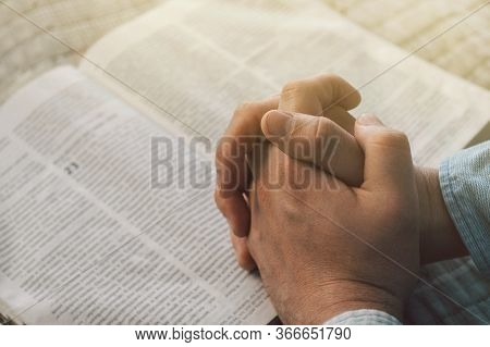 Reading The Bible. Prayer. Hands Folded In Prayer Concept. The Concept Of Faith, Spirituality And Re