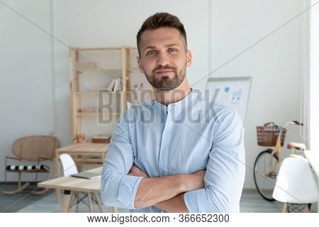 Close Up Headshot Portrait Picture Of Smiling Businessman Crossing Hands.