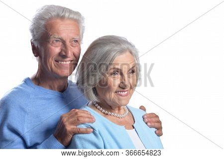 Happy Senior Couple Embracing And Posing Isolated