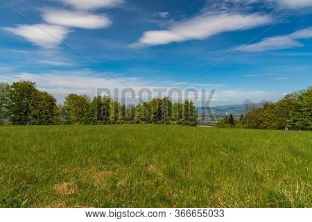 Godula Hill In Moravskoslezske Beskydy Mountains In Czech Republic With Meadow And Trees Around Duri