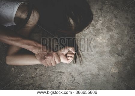 Man Hands Holding A Woman Hands For Rape And Sexual Abuse Concept. Stop Sexual Harassment And Violen