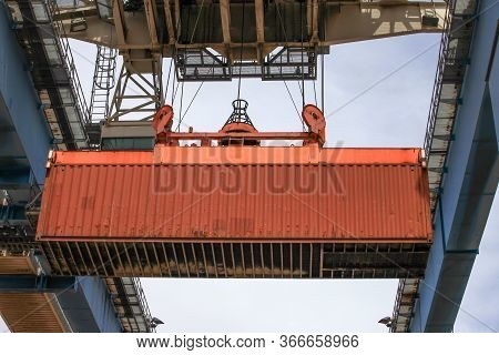 Crane Moving A Shipping Container To A Storage Platform.