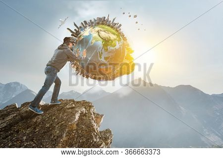 Young businessman in VR glasses rolling the Earth