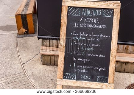 Montreal, Ca - 16 May 2020: Guidelines And Restrictions Written In French On A Chalkboard Outside A