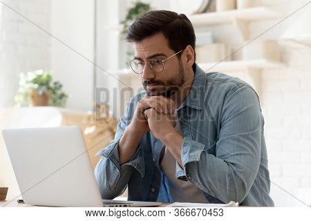 Pensive Man Work At Laptop At Home Thinking