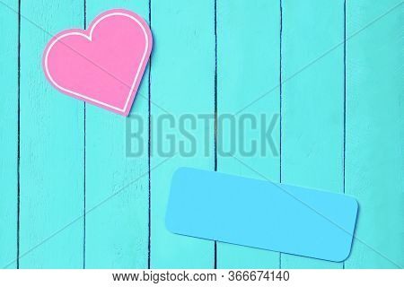 Pink Heart On A Blue Wooden Background And A Blue Plate. Copy Space. Background For Weddings, Valent