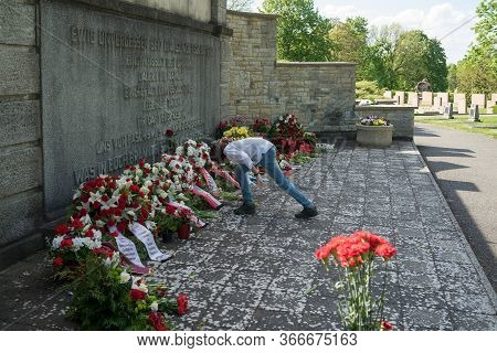 Seelow, Germany - May 09, 2020: A Boy Lays Flowers At The Foot Of The Monument To Soviet Soldiers At