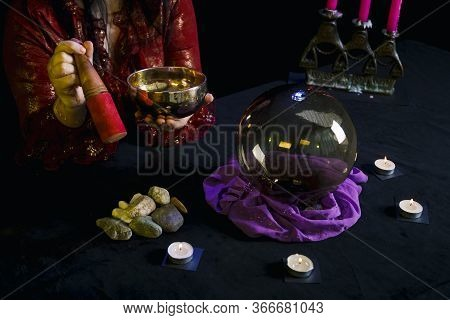 A Singing Cup In The Hands Of A Clairvoyant In A Magic Salon On A Black Background.