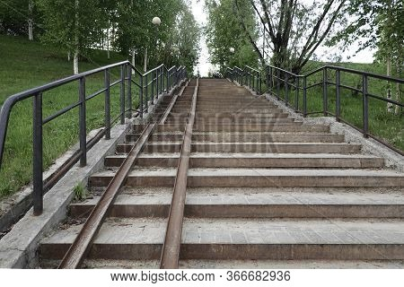 A Long Multi-arched Staircase In The Park, Equipped With A Ramp For The Descent And Ascent Of Childr