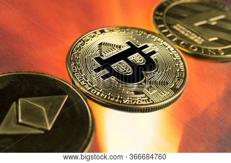 Physical Bitcoin, Litecoin And Ethereum Gold Coins With Fire Or Flame Background. Cryptocurrency Bul