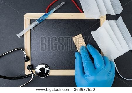 Blank Blackboard With Stethoscope, Syringe With Vaccine And Cut Face Mask. Hand In Protective Glove