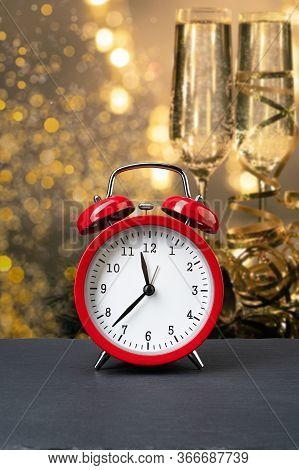 Vintage Red Alarm Clock On Dark Slate Plate With New Year's Eve Champagne In A Glasses. Time For Cel