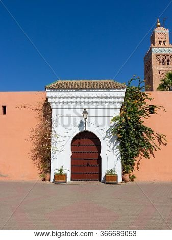 Decorated With Flowers White Archway In The Terracotta Wall Of The Kutubiyya Mosque, Marrakesh, Moro