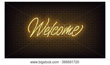 Yellow Neon Welcome, Lettering. Neon Text Of Welcome On Black Brick Background, Night Ambience. Nigh
