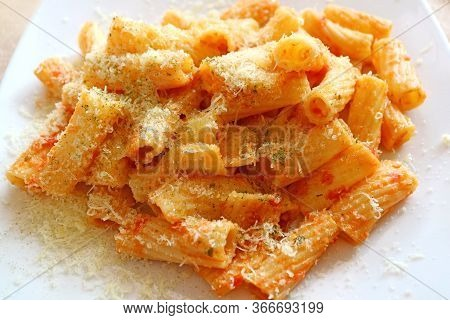 Closeup Creamy And Flavorful Rigatoni Pasta With Tomato Parmesan Sauce