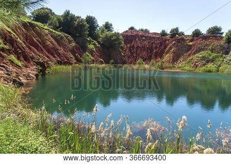 Bauxite Quarry Lake In Otranto, Puglia, Italy. Salento, Otranto: Lunar Landscape Of The Lake Of The