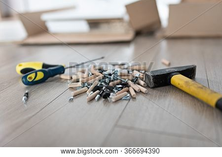 Various Types Of Screws, Connectors And Tools. Furniture Assembly Accessories.
