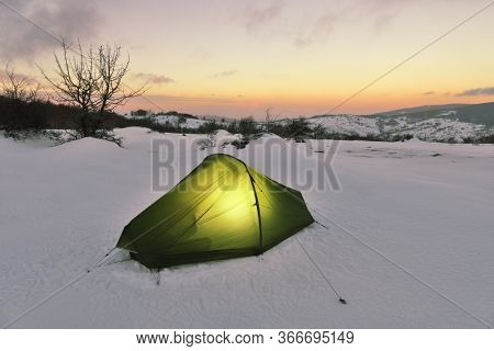 Sicily adventure in winter tent on snow of Nebrodi Mountains at the evening