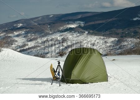 Sicily adventure in winter tent with snowshoes on snow in Nebrodi Mountains natural landmark