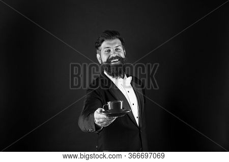 Join My Passion For Cup Of Pleasure. Happy Waiter Offer Hot Drink. Bearded Man Give Cup Of Coffee. G