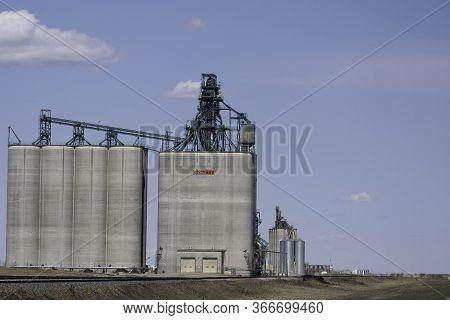 May 2 2020 - Vulcan, Alberta Canada - Modern Grain Elevator Near Railway Line