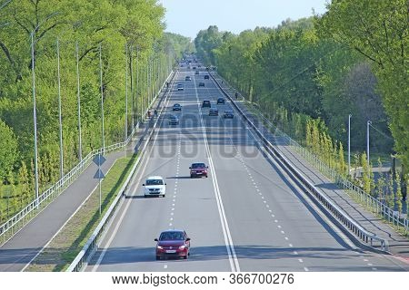 Chernihiv  / Ukraine - 10 May 2020 / Ukraine:  Panorama Of Highway With Green Trees And Bushes On Si