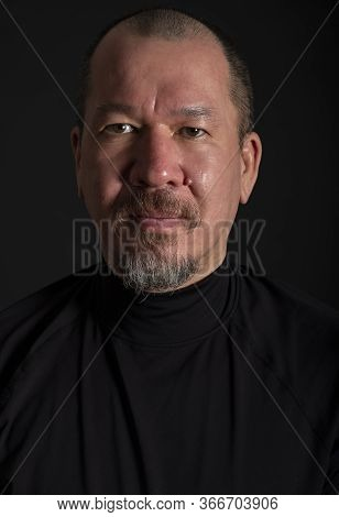 Studio Portrait Of A Handsome Mixed Race Man With A Beard On Black Background