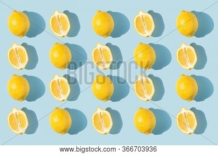 Pattern Of Lemons With Shadow On A Blue Background. Complementary Colors. Fresh Bright Fruits, Vitam