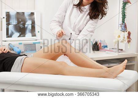 Neurologist Testing Knee Reflex Using Reflex Hammer. Neurological Physical Examination. Orthopedist
