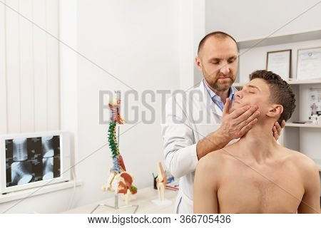 Manual Therapist Doing Manual Adjustment On Patient S Spine. Chiropractic, Osteopathy, Manual Therap