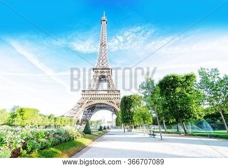 Paris Eiffel Tower Summer Flowers In Paris, France. Eiffel Tower Is One Of The Most Iconic Landmarks
