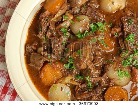 Beef bourguignon, traditional French stew with lardons, carrots, mushrooms and shallots.