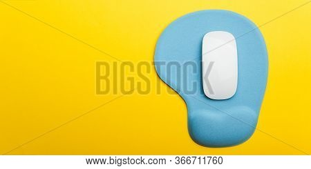 Top View Flat Lay Of Blue Pad Or Mousepad With Wireless White Computer Mouse Modern Design Isolated