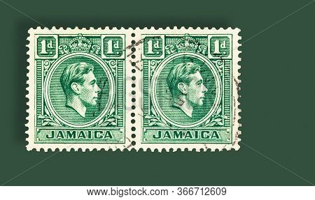 Seattle Washington - May 16, 2020:  King George Vi On Jamaica 1 Penny Stamp Of 1951, On Green Backgr