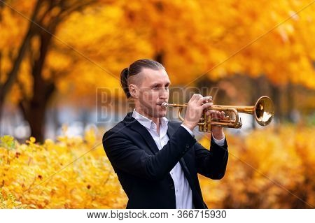 Young European Handsome Trumpeter In Formal Clothes Playing His Musical Instrument Golden Trumpet Am