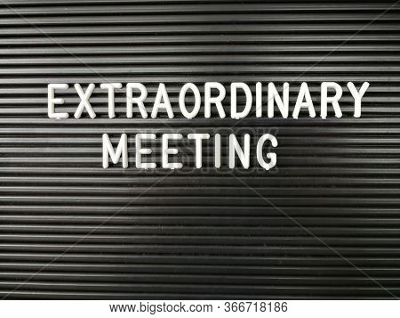 Extraordinary Meeting word on letterboard