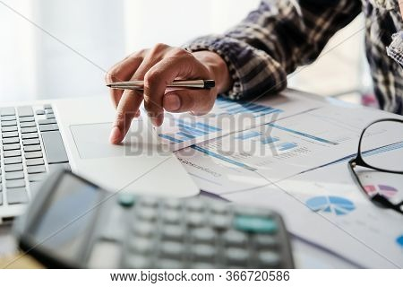 Business Man Or Accountant Working With Laptop Computer For Calculating Financial Accounting At Offi