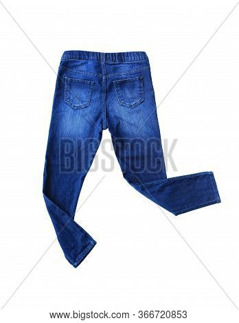 Blue Jeans Isolated Over White Background. Small Denim Child Clothes. Back View