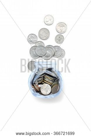 Coins In Money Glass Jar And Overflow Isolated On White Background. Saving Investment Concept.