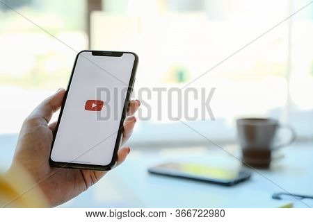 Chiang Mai, Thailand - Mar 7 , 2020: Woman Holding Iphone Xs With Youtube Apps On Screen.