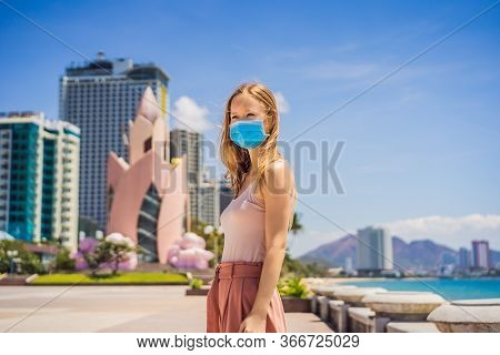Woman Tourist In Vietnam, Nha Trang Put On A Medical Mask To Protect Herself From Coronovirus Infect