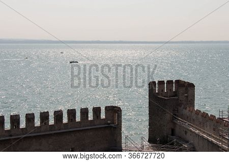 Italy, Lombardy - August 05 2018: The View Of The Scaliger Castle Fortificated Walls With Horizon Li