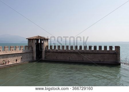 Italy, Lombardy - August 05 2018: The View Of The Scaliger Castle Fortification Walls On August 05 2