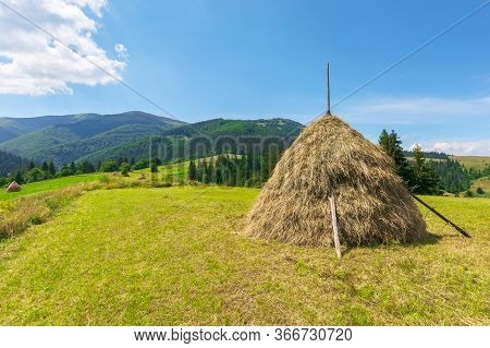 Idyllic Rural Landscape On A Sunny Summer Day. Idyllic Rural. Hay Stack On The Field. Wonderful Coun