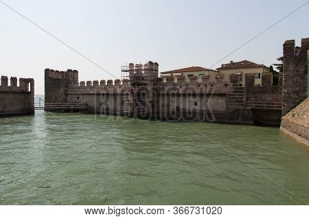 Italy, Lombardy - August 05 2018: The View Of The Scaliger Castle Fortification Wall Reconstruction