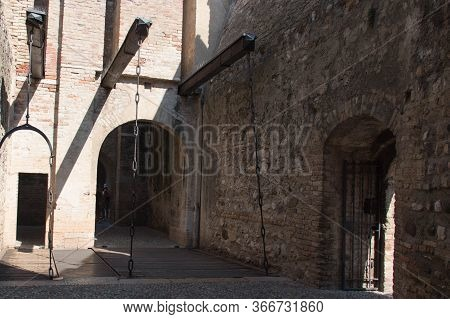 Italy, Lombardy - August 05 2018: The View Of The Walls And Bridge Mechanism Of Scaliger Castle On A