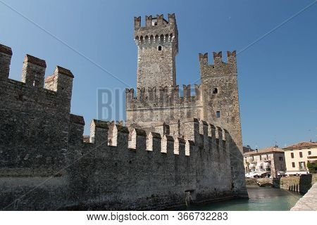 Italy, Lombardy - August 05 2018: The View Of Scaliger Castle And Water Moat On August 05 2018 In Si
